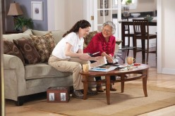 Senior Helpers Cutting Coupons.JPG